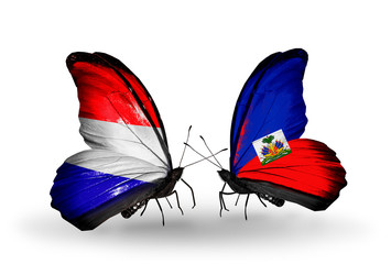 Two butterflies with flags Holland and Haiti