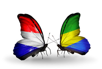 Two butterflies with flags Holland and Gabon