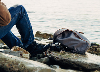 Traveler resting on coastline