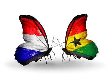 Two butterflies with flags Holland and Ghana