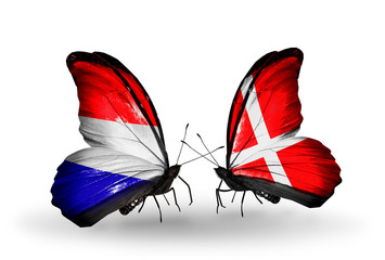 Two butterflies with flags Holland and Denmark