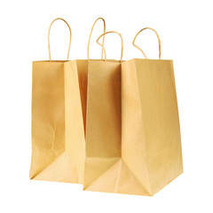 Empty brown recycled paper shopping bags isolated on white backg