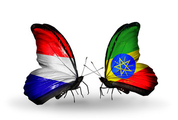 Two butterflies with flags Holland and  Ethiopia