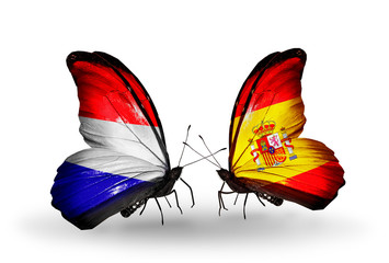 Two butterflies with flags Holland and Spain