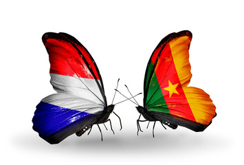 Two butterflies with flags Holland and Cameroon
