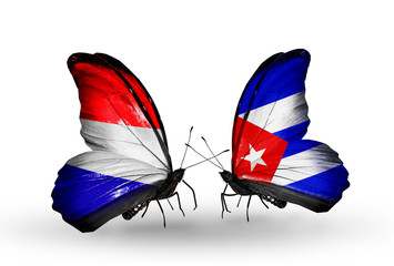 Two butterflies with flags Holland and Cuba