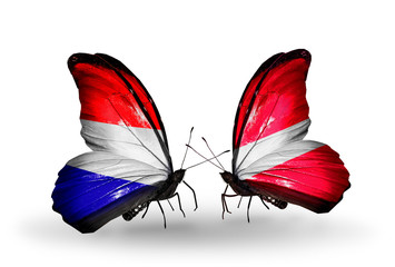 Two butterflies with flags Holland and Latvia