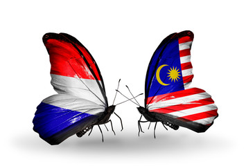 Two butterflies with flags Holland and Malaysia