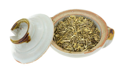 Organic wormwood in bowl with lid