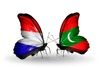 Two butterflies with flags Holland and Maldives