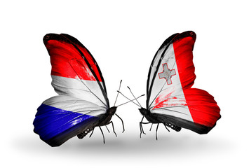 Two butterflies with flags Holland and Malta