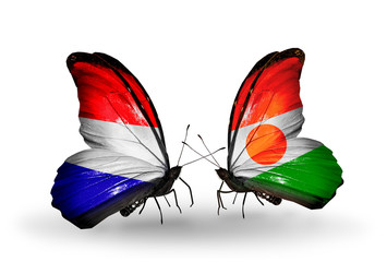 Two butterflies with flags Holland and Niger