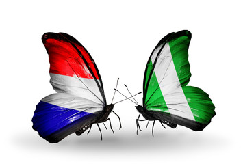 Two butterflies with flags Holland and Nigeria