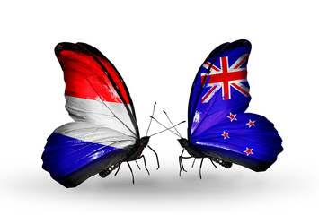 Two butterflies with flags Holland and New Zealand