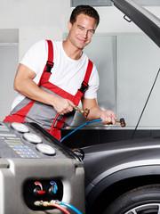 Car mechanic checks the air handling unit of a car