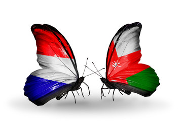Two butterflies with flags Holland and Oman