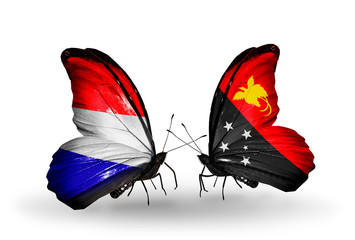 Two butterflies with flags Holland and Papua New Guinea