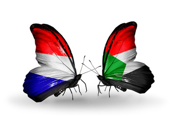 Two butterflies with flags Holland and Sudan