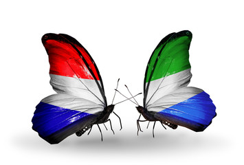 Two butterflies with flags Holland and Sierra Leone