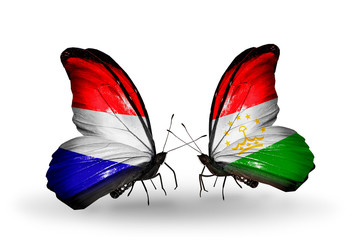 Two butterflies with flags Holland and Tajikistan