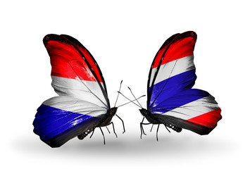 Two butterflies with flags Holland and Thailand