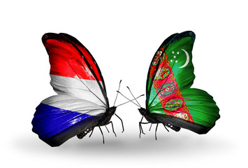 Two butterflies with flags Holland and Turkmenistan