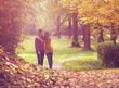 Love couple walking in the colorful autumn  forest