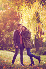 Couple embracing on colorful autumn forest