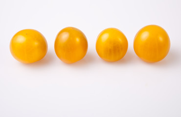 Yellow shiny cherry tomatoes