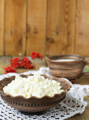 Cottage Cheese and milk in a clay pot
