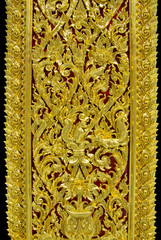 Ancient golden carving wooden in Thai temple Thailand