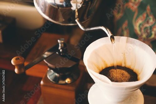 Fotobehang Koffie vintage color tone : cup of coffee in coffee shop