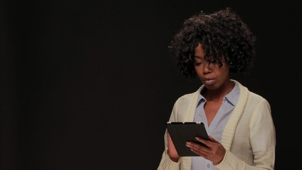 Young African American black woman using tablet pc