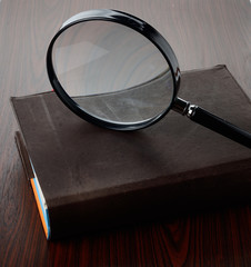 Magnify glass with a book