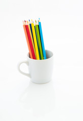 Color pencils in white coffee cup