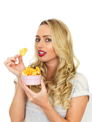 Young Woman Eating Potato Crisps