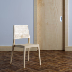 Wooden chair near the door in room interior with parquet