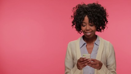 Young African American black woman texting cellphone