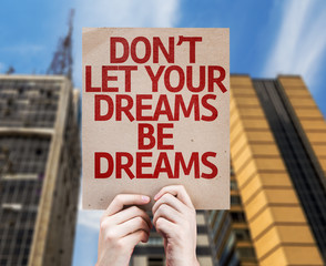 Don't Let Your Dreams Be Dreams card with a skyscraper