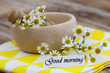 Good morning card with fresh chamomile flowers