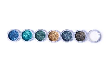 Set of bright glitters in jars
