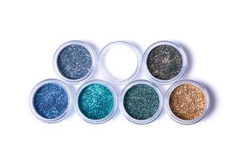 Two rows of metallic glitters in jars