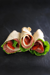 italian wraps with hard salami and lettuce
