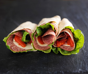 italian wraps with hard salami, lettuce, provolone cheese