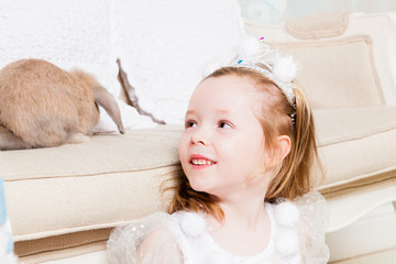 Pretty little girl with rabbit