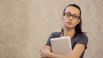 Serious Woman in Glasses With tablet PC Loking Straight