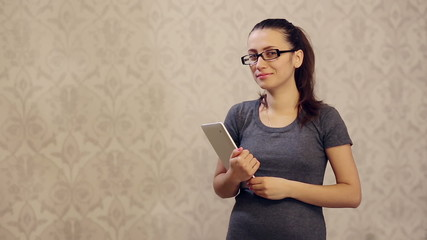 Smiling Woman in Glasses With tablet PC Loking Straight