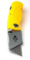 Yellow stationery knife isolated on white