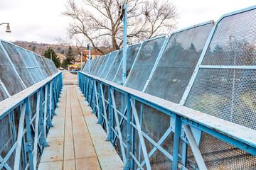 Blue pedestrian bridge over railroad