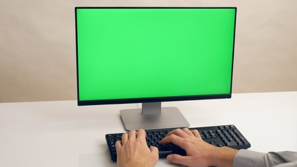 Hands typing keyboard. Green screen PC. Ultra HD, 4K